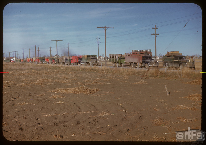 37 trucks waiting at Regina co-op stock yards.  Regina.  10/27/1947