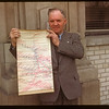 Clayton Frith of Yorkton holding Livestock Pool loading map..  Regina.  04/15/1948