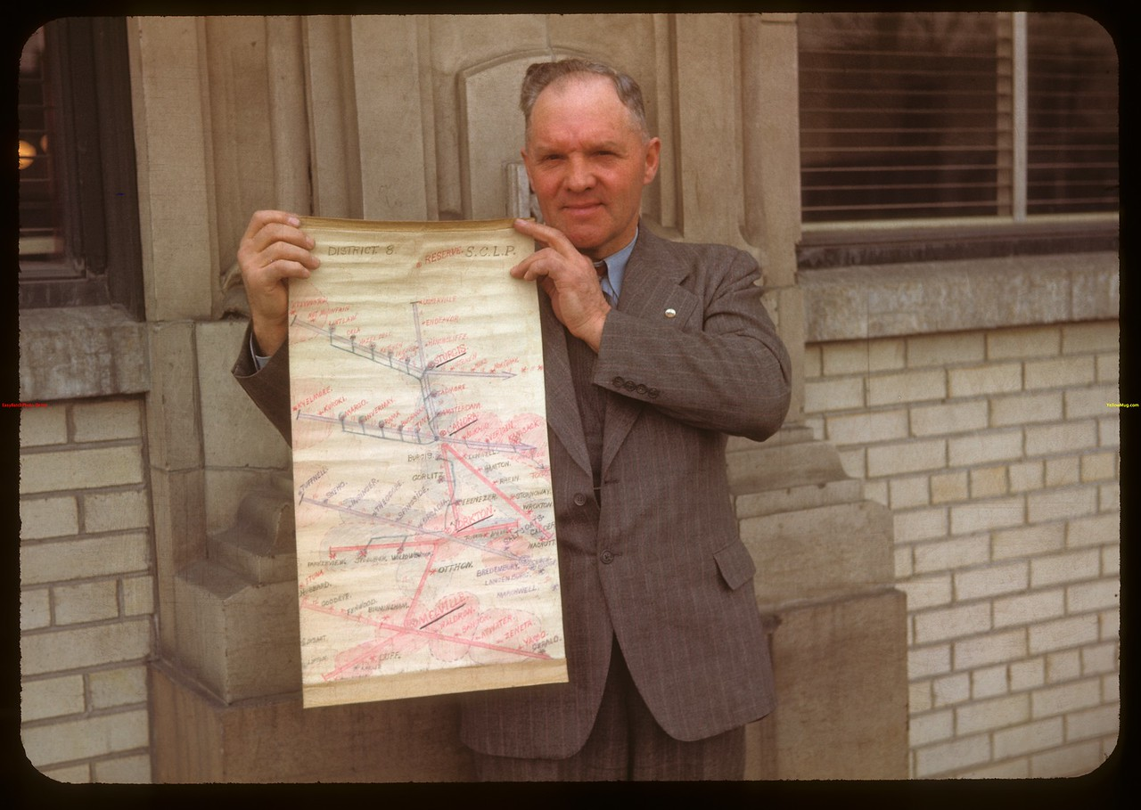 Clayton Frith of Yorkton holding Livestock Pool loading map..  Regina.  04/15/1948