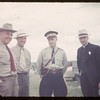 J. E. McNabb - Cost. Lee and Father Chabot at Jubilee parade.  Val Marie.  06/06/1955