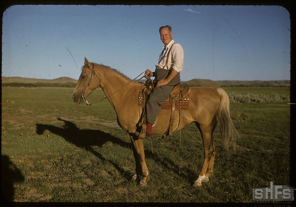 Everett Baker on horse back.  Val Marie.  06/29/1957