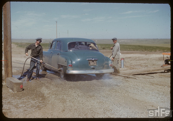 """""""Foot & Mouth"""" disinfection about 10 miles E. of Moose Jaw. Moose Jaw. 06/05/1952"""