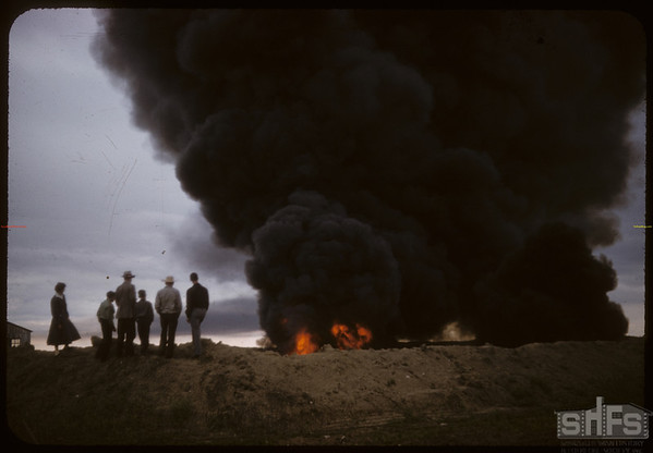 Oil sludge fire from 7 wells near Bill Meyers NE of Shaunavon..  Shaunavon.  06/30/1958