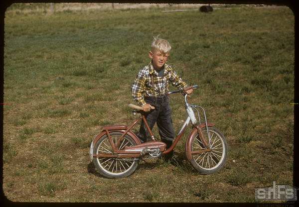 Henry Sand with bike..  Shaunavon.  06/12/1957