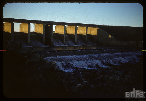 West dam spillway against the sun.  Val Marie.  10/05/1954