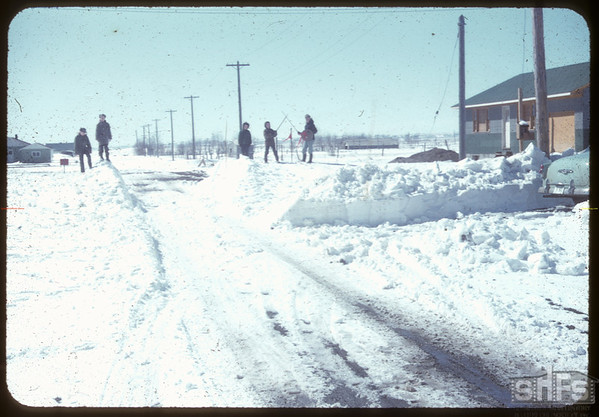 School kids and snow bank..  Shaunavon.  04/05/1955