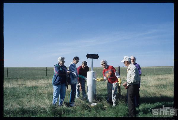 How many people does it take to paint a post - working on the NWMP Trail east of Mankota.  Terri Prince - Velma Rosenburger - Finn Anderse - Pat Wagner & Henri Lebastard & Rosemary Torjusen.  Mankota.  05/19/2000
