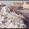 Claude Pickett standing on snow bank on 3rd Ave..  Shaunavon.  03/26/1951