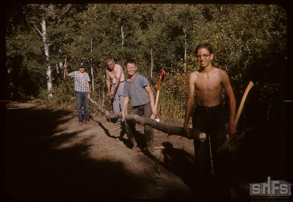Boy Scouts with Teepee Poles - Pine Cree Park [from right - Barrett Halderman; Frank Halderman; Jack Pearpoint & Bob Arnold - picture donated to SHFS by Barrett Halderman].  South Fork.  08/16/1958