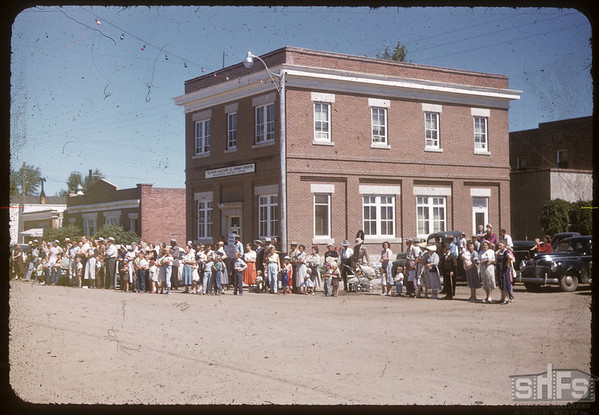 Crowd watching Jubilee Fair Parade.  Shaunavon.  07/26/1955