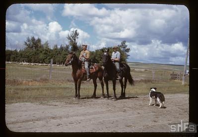 Jim Cooper & Sam Johnson on horse back, Admiral, 08/26/1950
