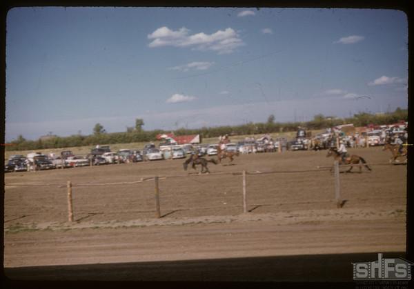 Shaunavon rodeo - bronco busting.  Shaunavon.  07/23/1957