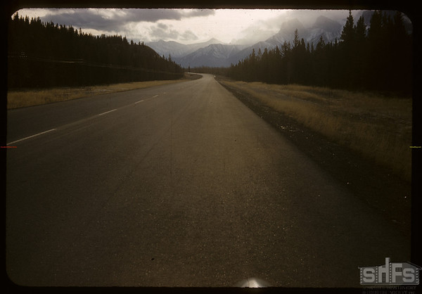 Very little snow [no snow at side of road]..  Banff.  01/14/1958