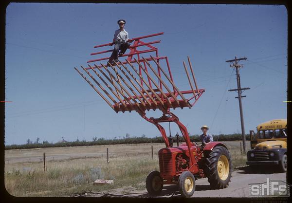 Shaunavon Fair Parade - Tractor lifter.  Shaunavon.  07/26/1950