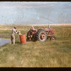 Arnold Olson hauling water.  Frontier.  08/08/1956