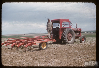 Alvie Hedstrom with tool bar cultivator, Admiral, 07/06/1957