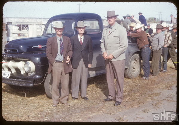 Angus Willes and Harry Otterson at A. W. Horse sale.  Shaunavon.  09/25/1953