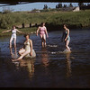 Posing in the river but not wanting to get wet - Phyllis Clark - Patsy Myrhaugen - Virginia Howlett and Jean Clark.  Swift Current.  07/08/1953