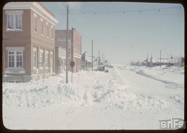 Snow clogged streets.  Shaunavon.  03/12/1951