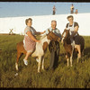 Mrs Baird and Mrs King ready for a ride.  Swift Current.  07/04/1954