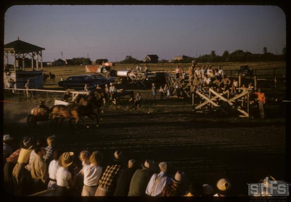Shaunavon rodeo - chariot racing.  Shaunavon.  07/23/1957