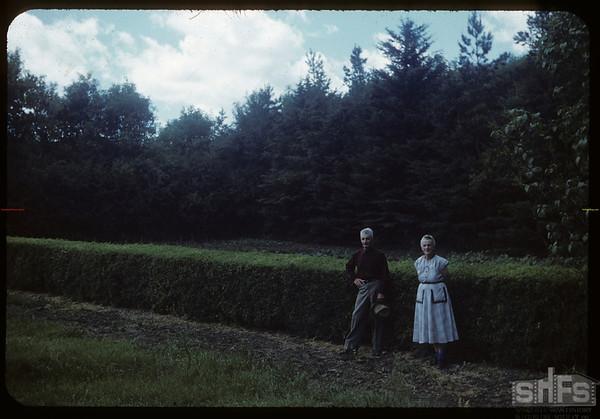 Mr & Mrs  Dick de Cock - garden is behind hedge.  Wood Mountain.  07/07/1954