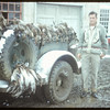 "M. Twasivk and ""Ducks Unlimited"" [1/2 ton truck full of hunted ducks]..  Shaunavon.  09/30/1954"