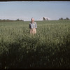 "R. P. (Dick) Robbins ""1951 World Wheat King"" standing in field.  Shaunavon.  07/19/1956"
