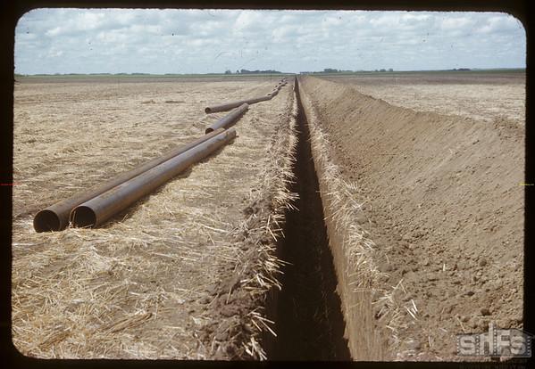 Laying gas pipe to Saskatoon.  Vanscoy.  06/28/1953