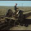 Crude oil and gravel mix - west of Shaunavon.	 Shaunavon.	 10/20/1954
