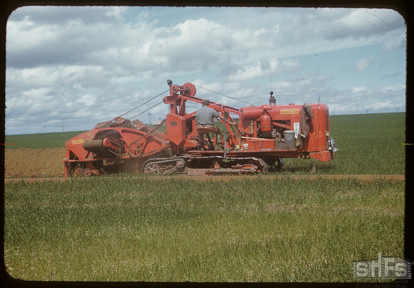 Trench digging machine for gas pipe to Saskatoon.  Vanscoy.  06/28/1953