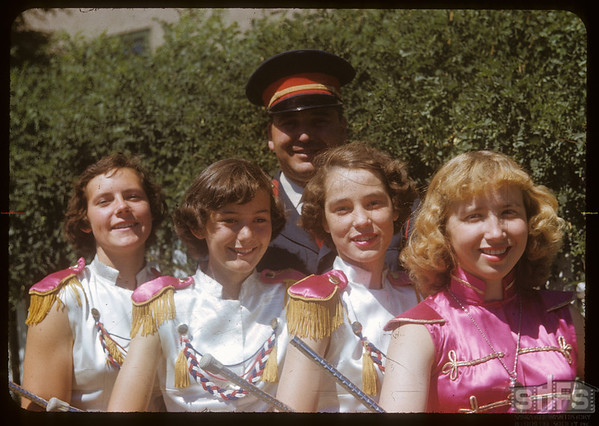 Director Tommy Toddington and Majorettes of the Moose Jaw Junior Band at the Shaunavon fair..  Shaunavon.  07/23/1953