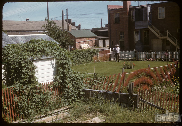 Tom March on the alley from SW.  Shaunavon.  07/29/1955