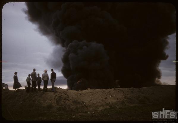 Oil sludge fire from 7 wells near Bill Meyers NE of Shaunavon..  Shaunavon.  06/30/1958