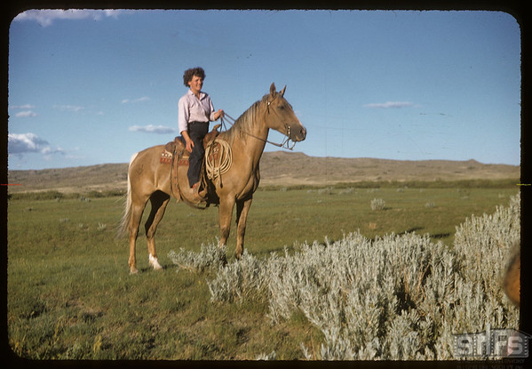 Nora Gillespie on horse back.  Val Marie.  07/29/1957
