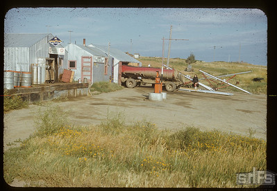 Mrs. Howard Williamson at Admiral co-op oil station, Admiral, 08/14/1952