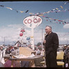 Mayor Jensen addressing official opening of Co-op service station.  Shaunavon.  06/27/1957