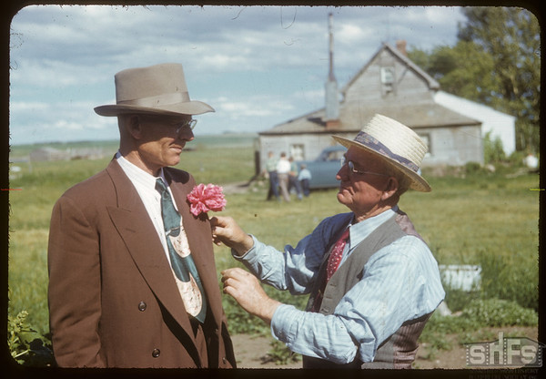 Arthur Blomme - host - decorates Director Tom Babier..  Shaunavon.  07/01/1952