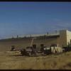 Roofing new Co-op lumber yard.  Shaunavon.  11/27/1954