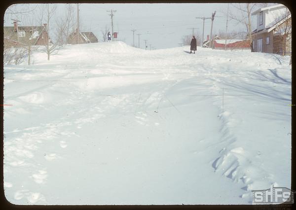 Biggest snow bank..  Shaunavon.  03/19/1951