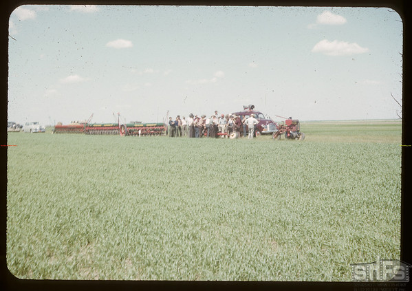 Co-op school - examining seeding equipment at Experimental Farm.  Swift Current.  07/05/1950