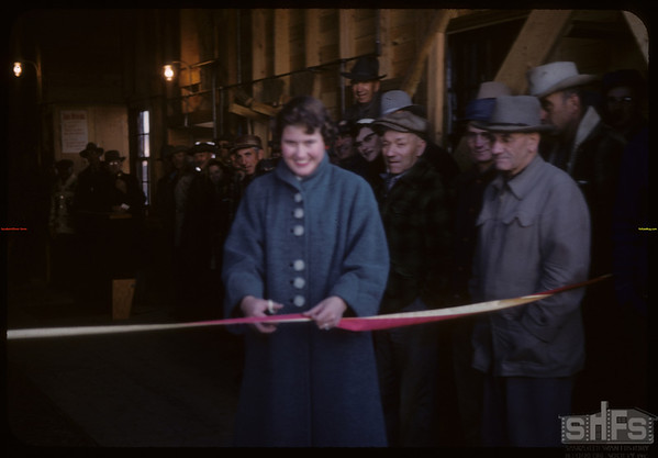 Official opening new composite elevator - Joyce Fritz with ribbon cutting.  Shaunavon.  11/21/1957