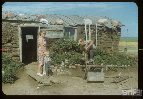 Sod House - Mr. & Mrs. [Beth Ellen] Sid Cheeseman; sod house built by John Waddell about 1911 or 1912 - Waddell (moved) to Weyburn in early 1940s. McCord. 08/14/1954