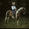 Mrs. Ismond on horse back.  Shaunavon.  08/23/1954