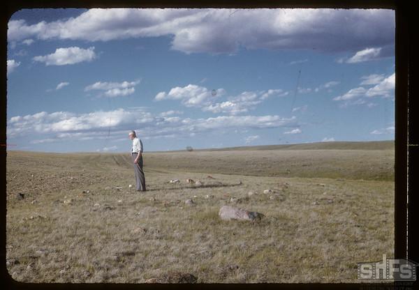 Joe Buckley examining Tipee rings on McNabb ranch.  Val Marie.  06/29/1957