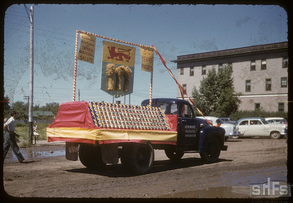 Jubilee Fair Parade - MacDonalds Consolidated float.  Shaunavon.  07/26/1955