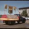 Jubilee Fair Parade - MacDonalds Consolidated float.  Shaunavon.  07/26/1955