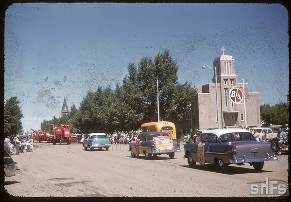 Jubilee Fair Parade past Cenotaph.  Shaunavon.  07/26/1955