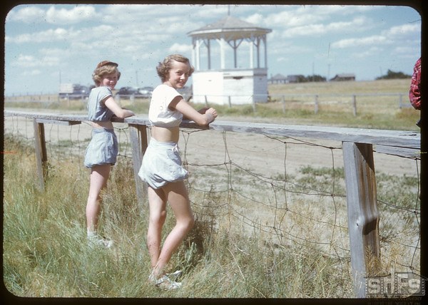 Carol Meyer & Luella Ellingson watching races - Shaunavon Fair..  Shaunavon.  07/25/1950