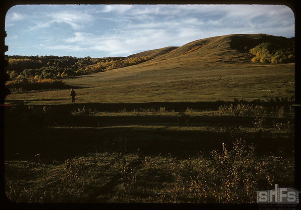 Dick DeCock standing at site of Loui Legare's trading post - about 1/2 mile west of Mergal's ranch buildings.  Wood Mountain.  09/25/1957